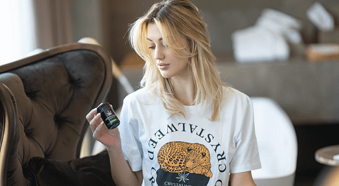 woman holding CBD product