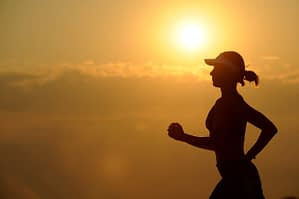 a woman exercising in the morning