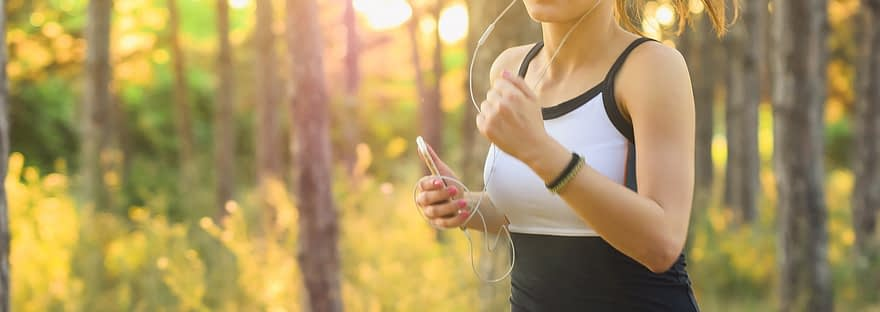 lady listening to music while jogging