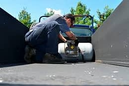 person assessing fuel tank